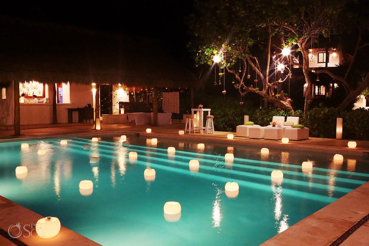 floating candle installation Hotel Escencia Xpu Ha wedding reception ideas