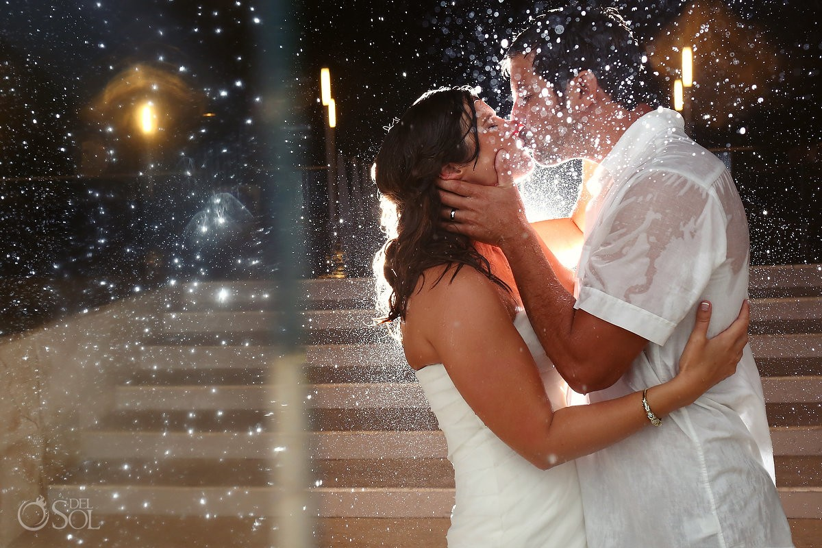Playacar Palace rainy wedding photos with bride and groom