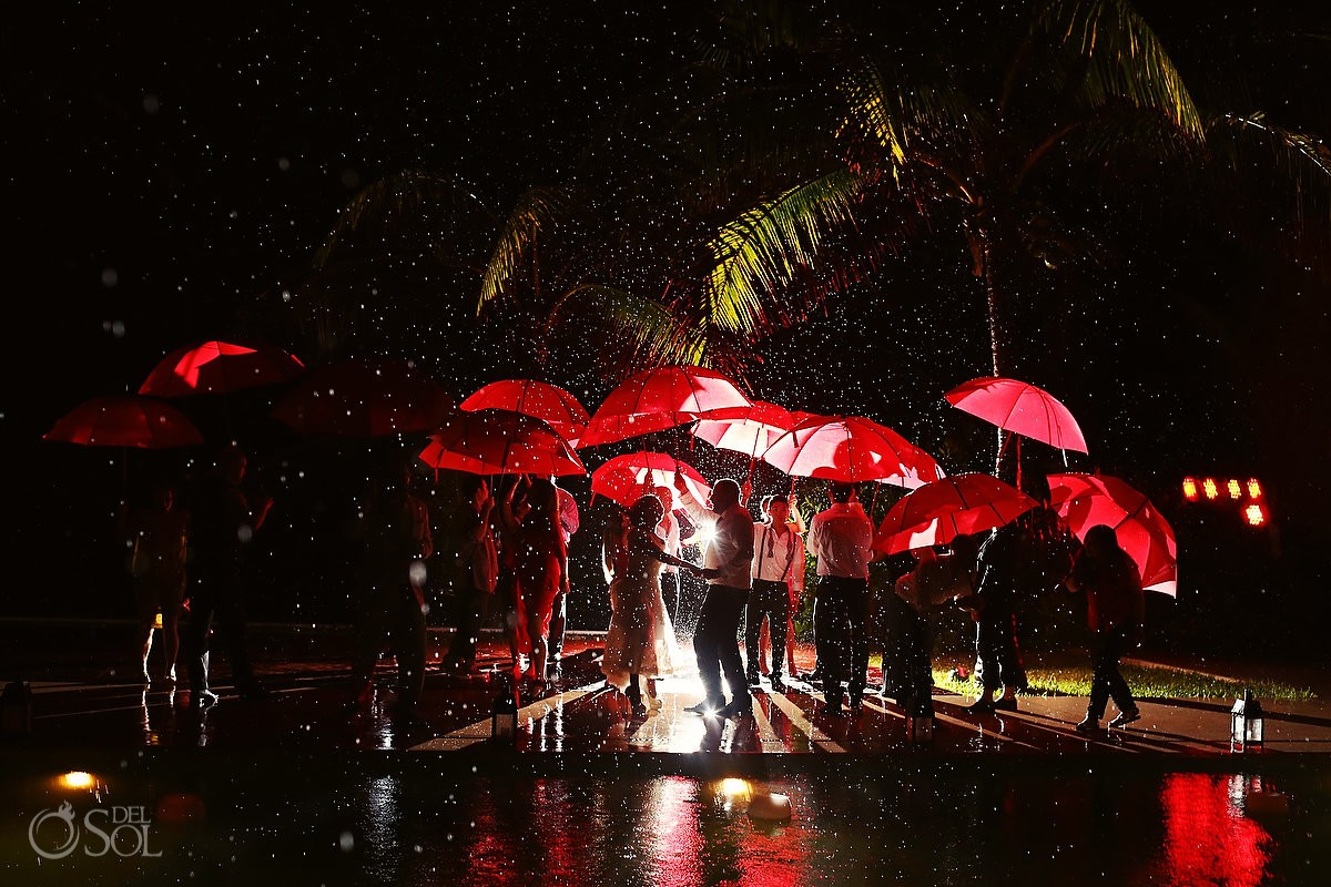 entire wedding party dances in the rain at Esencia Hotel, Mexico.