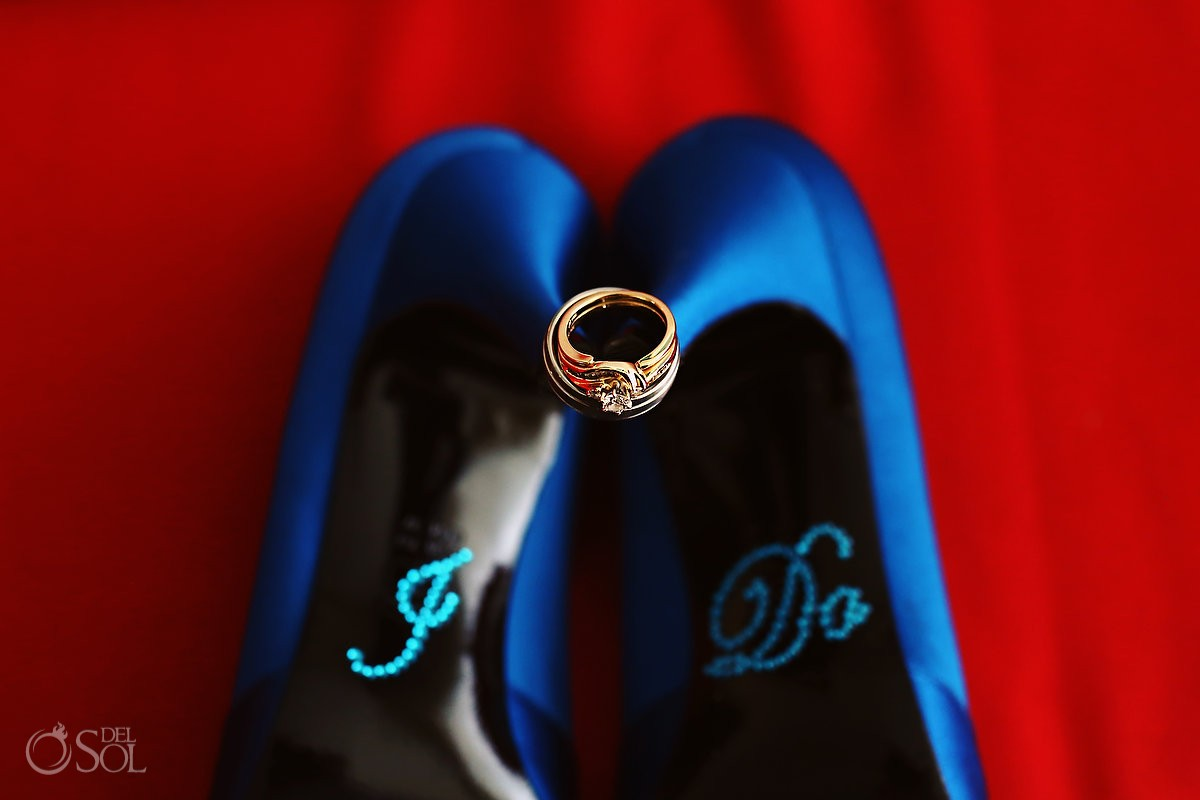 wedding rings on blue shoes with I do
