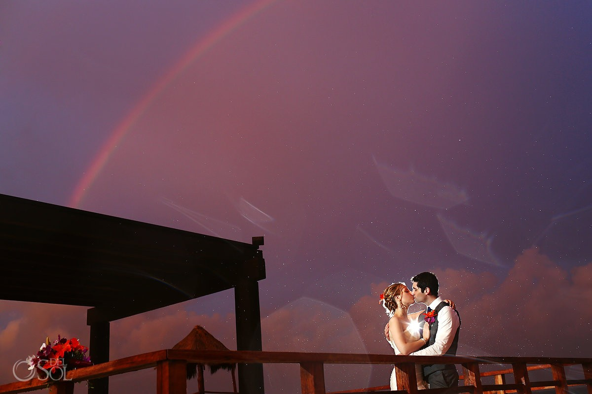 bride and groom with epic rainbow at Now Jade Resort