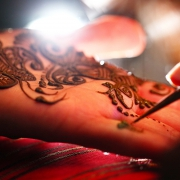 Applying mehndi on hands Hindu Indian Wedding Riviera Maya Iberostar Mexico