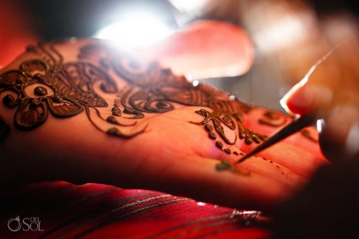 Applying mehndi on hands Hindu Indian Wedding Riviera Maya Iberostar Mexico