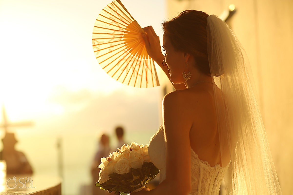 Bride waving a fan