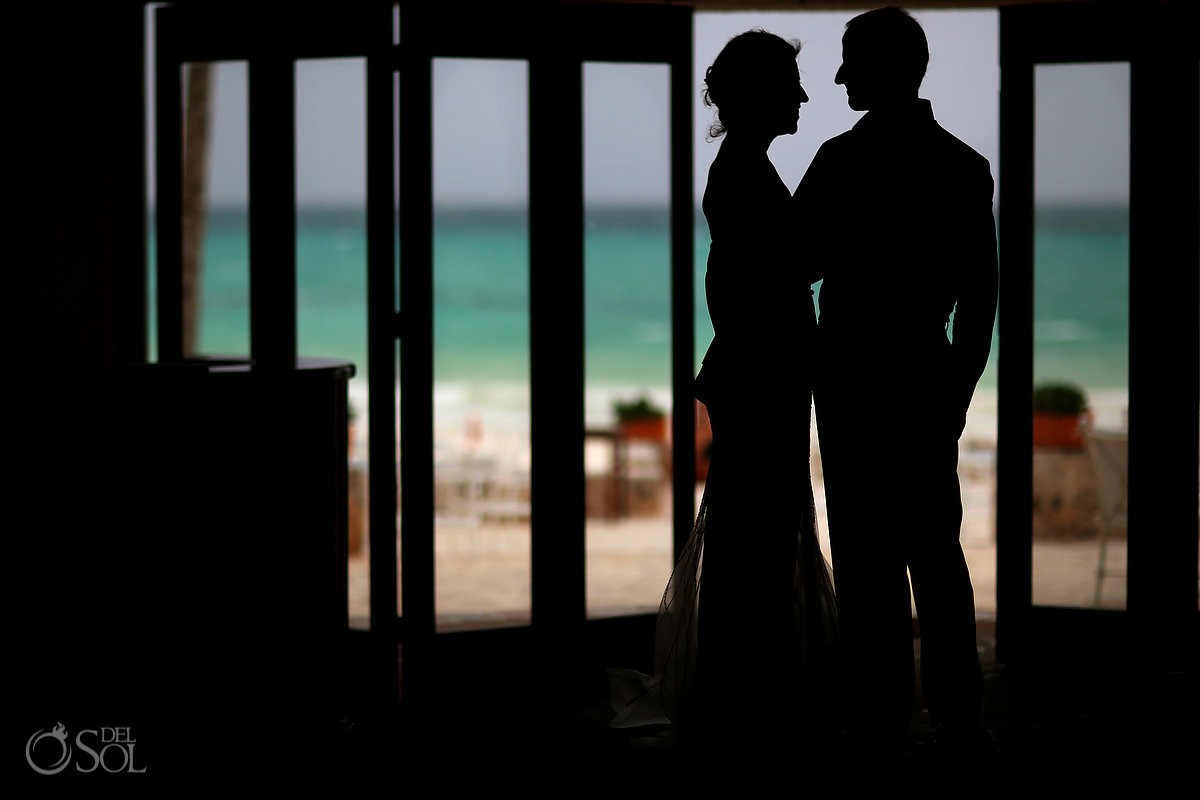 Shilouette destination wedding photograph of bride and groom at Belmond Maroma Resort