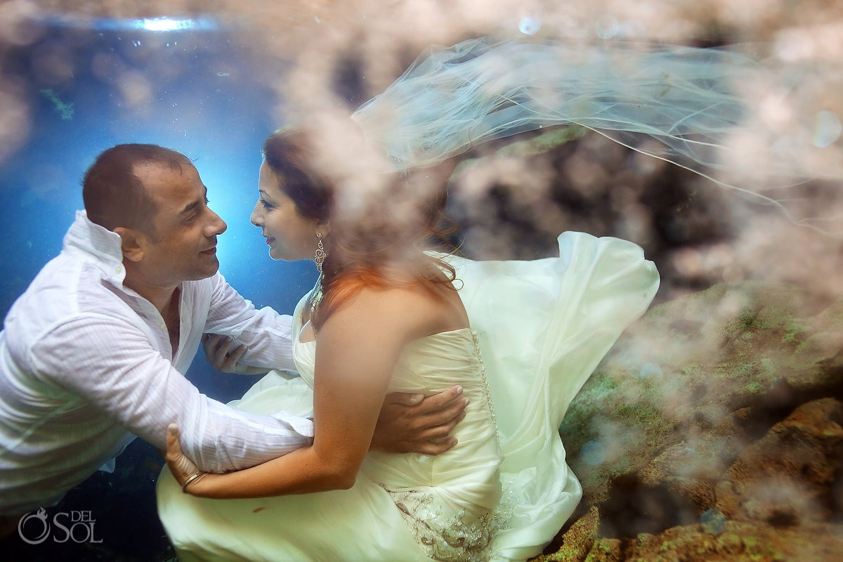 Underwater trash the dress cenote Riviera Maya Mexico