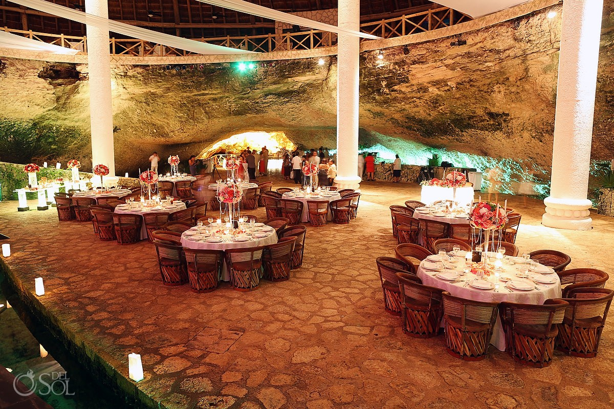 Table set ups at a wedding reception at La Isla restaurant in Xcaret Park, Riviera Maya, Mexico