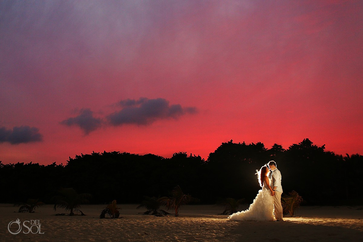 Playa del Carmen beach trash the dress. Mexico wedding photographers Del Sol Photography