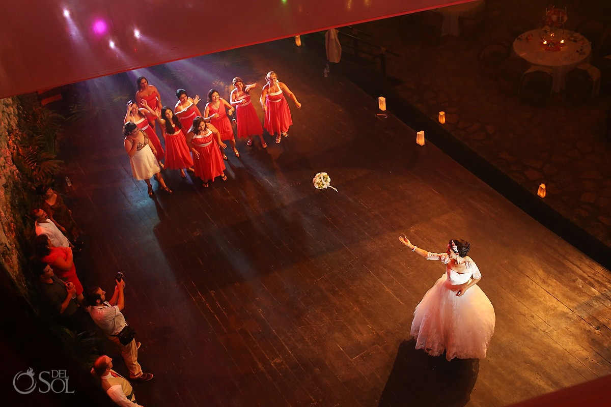 Bouquet toss at their wedding reception at La Isla restaurant in Xcaret Park, Riviera Maya, Mexico