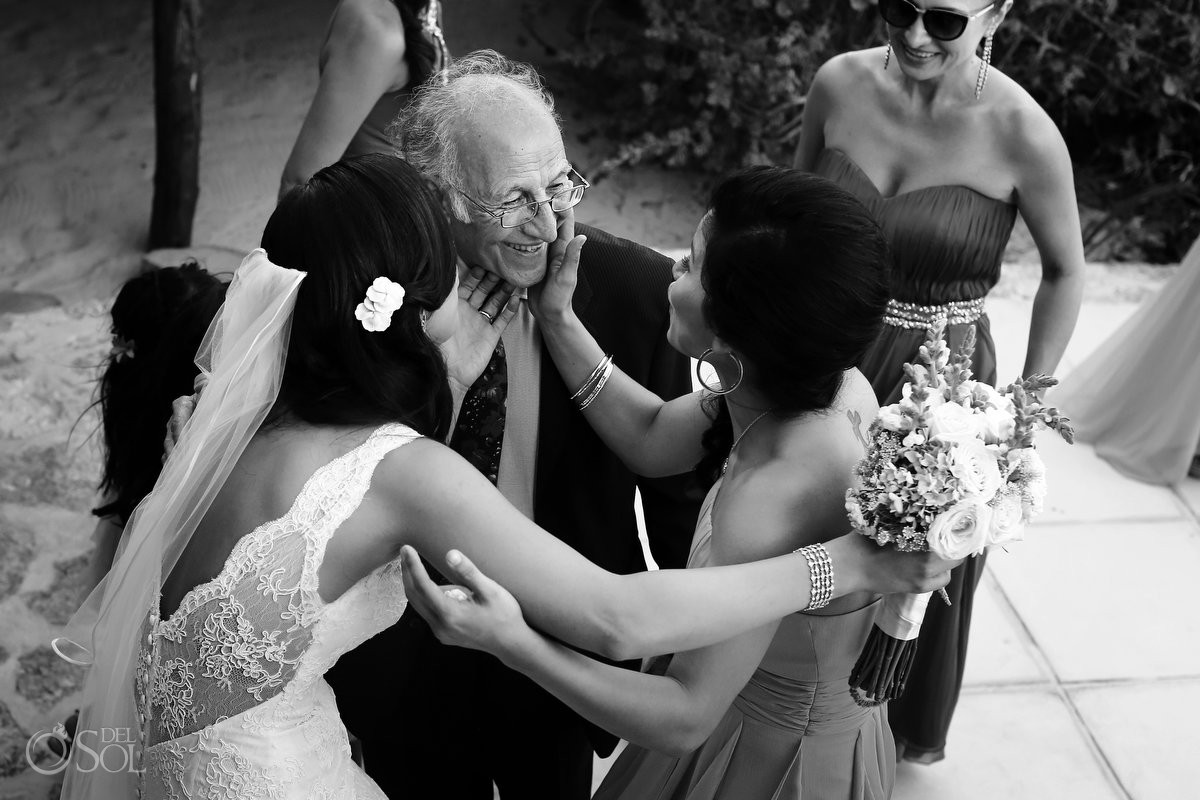 Father is hugged and loved by daughters and bride at destination wedding in Rosewood Mayakoba