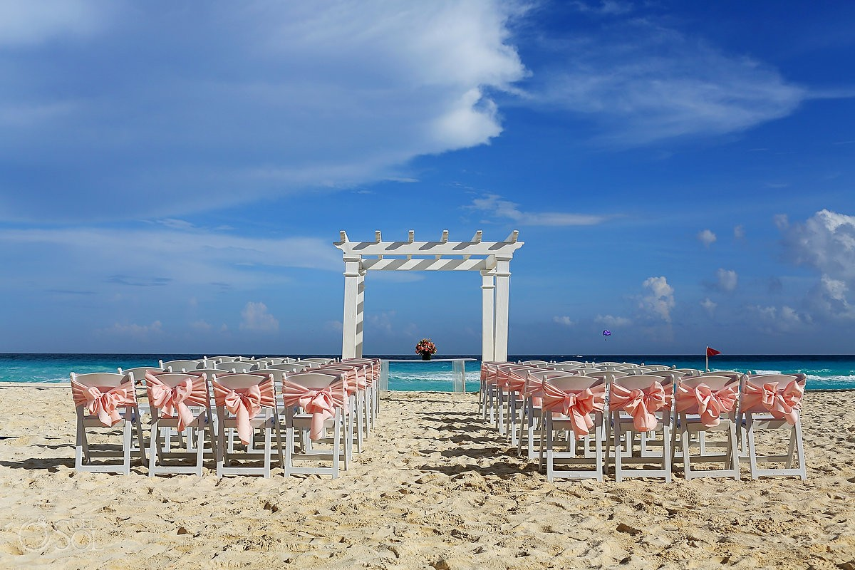 destination wedding beach ceremony setup at Secrets the vine cancun mexico