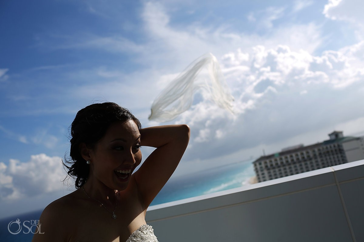 Bride loosing veil in the wind at Secrets the Vine Mexico