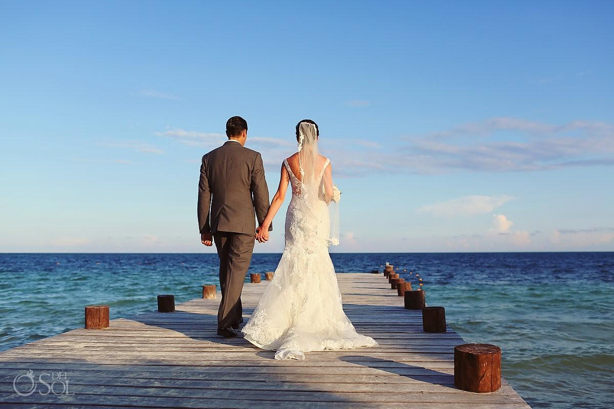 destination beach wedding Secrets Capri bride and groom on the pier