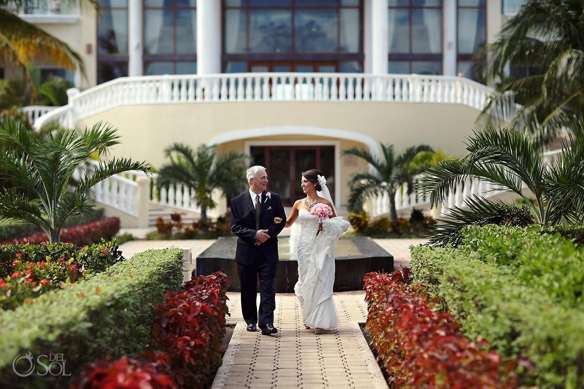 bride and father prepare to walk the aisle at dreams tulum hotel