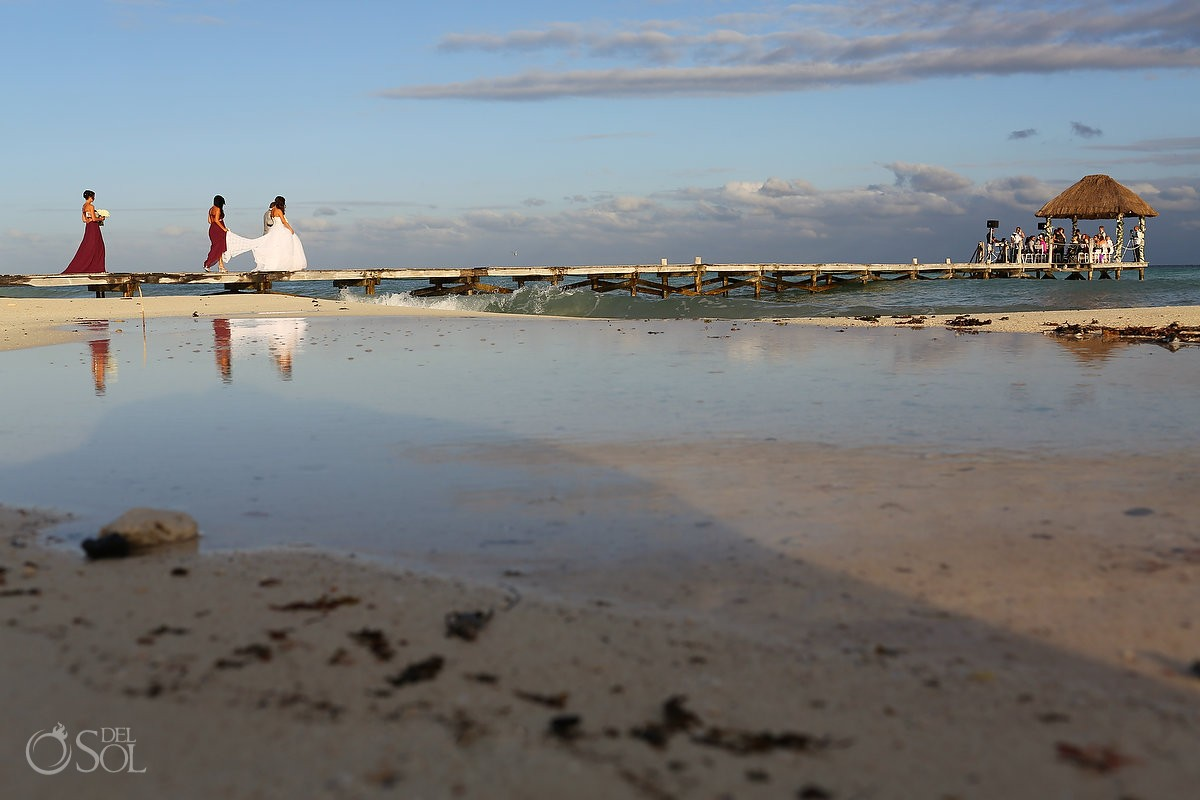 Epic destination wedding processional on the dock the Viceroy Hotel Mexico