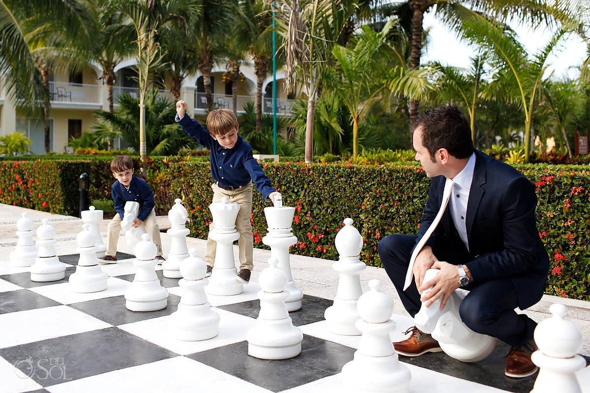 groom and children on chessboard at dreams tulum hotel in mexico