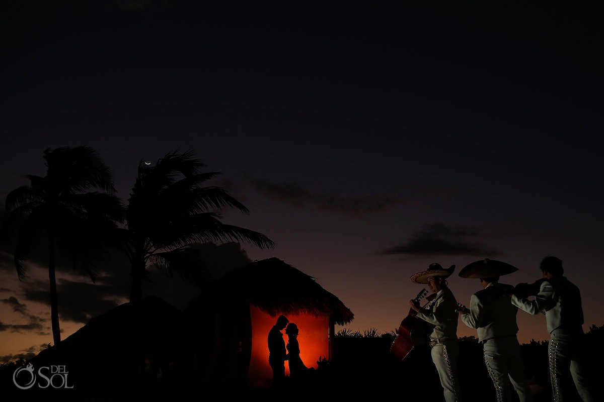 mariachi serenading a bride and groom at dreams tulum