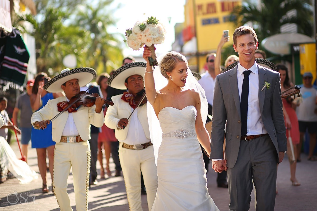 bride and groom walking down 5th Avenue after Playa del Carmen Chapel Capilla Nuestra Señora del Carmen