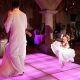 flowergirl dancing on the dance floor in wedding reception at xcaret