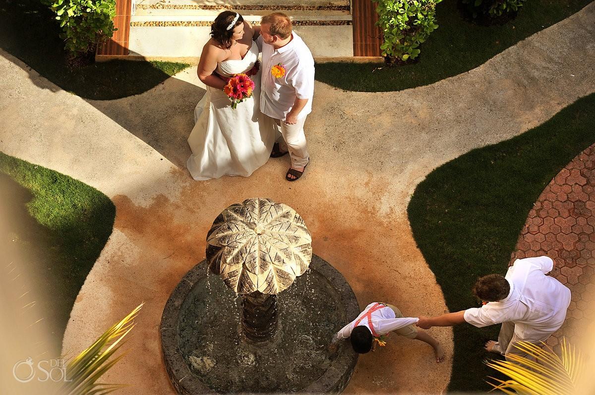 Kid photobombs wedding portraits bride groom