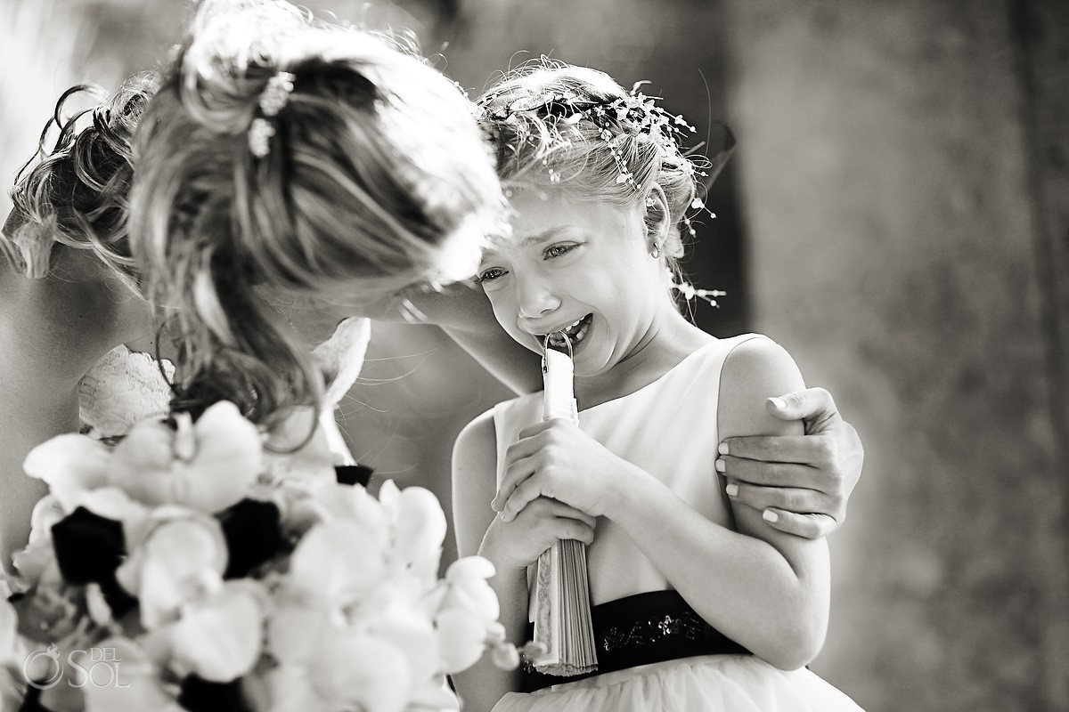 Small flowergirl crying during a wedding ceremony at Zoetry Paraiso Mexico