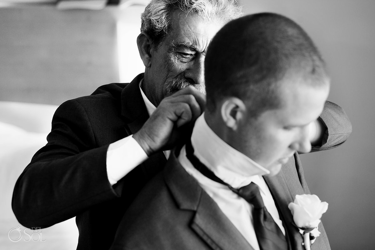 Father helps groom dress for his wedding at beach palace cancun