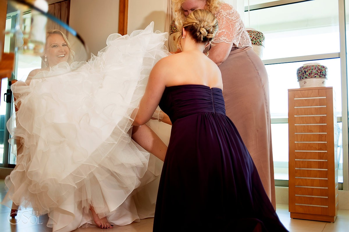 bride getting ready at Beach palace with Mori lee gown