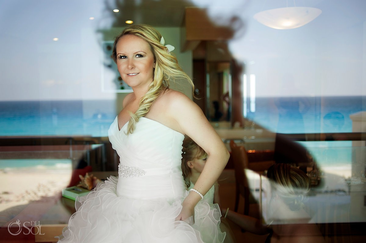 destination wedding photo of bride with mori lee gown at beach palace cauncun