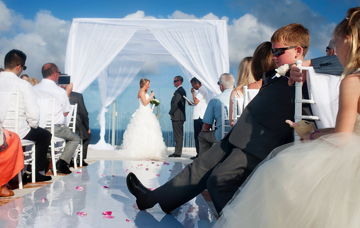 destination wedding photo of rooftop ceremony at beach palace cauncun