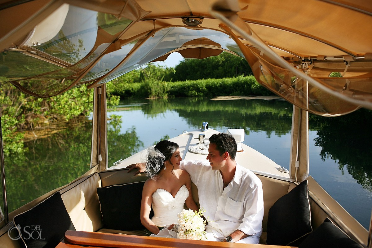 Bride and groom in canal on boat Wedding Rosewood Mayakoba
