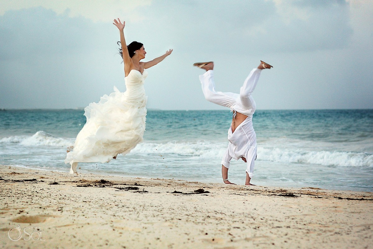 Wedding Rosewood Mayakoba bride and groom cartwheels