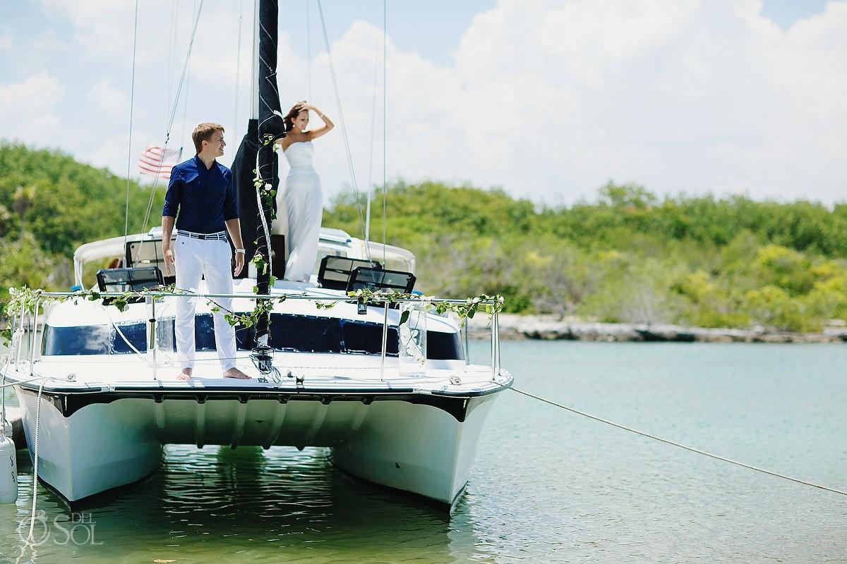 wedding couple ride a catamaran from puerto aventuras