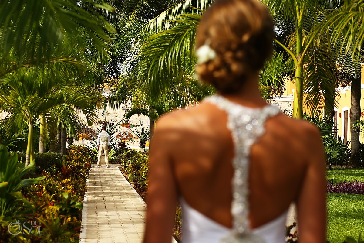 bride and groom first look in the garden at dreams tulum hotel