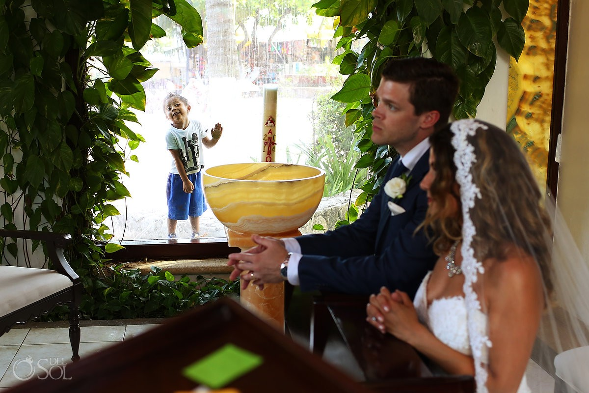 Kid photobombs Catholic wedding ceremony Playa del Carmen