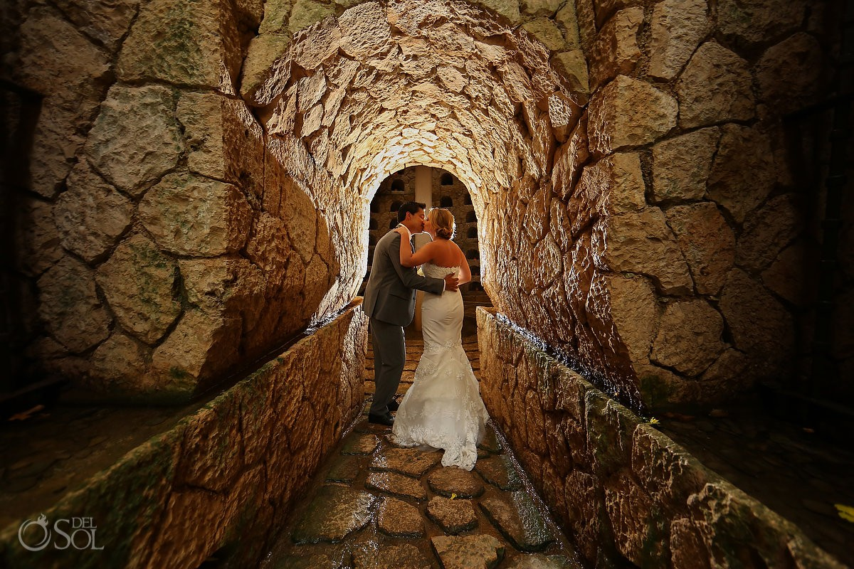 Bride and groom wedding portrait kissing at Xcaret Park graveyard, Playa del Carmen, Mexico
