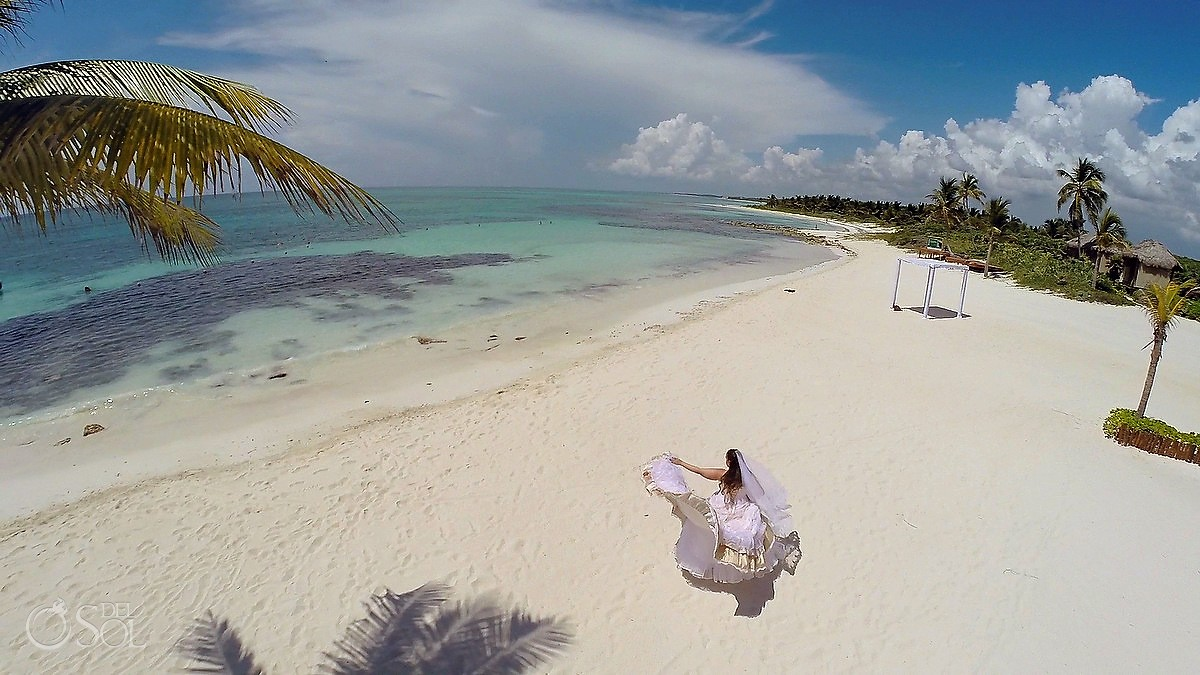 bride on the beaches of Dreams tulum hotel in the Mexican Riviera Maya Caribbean