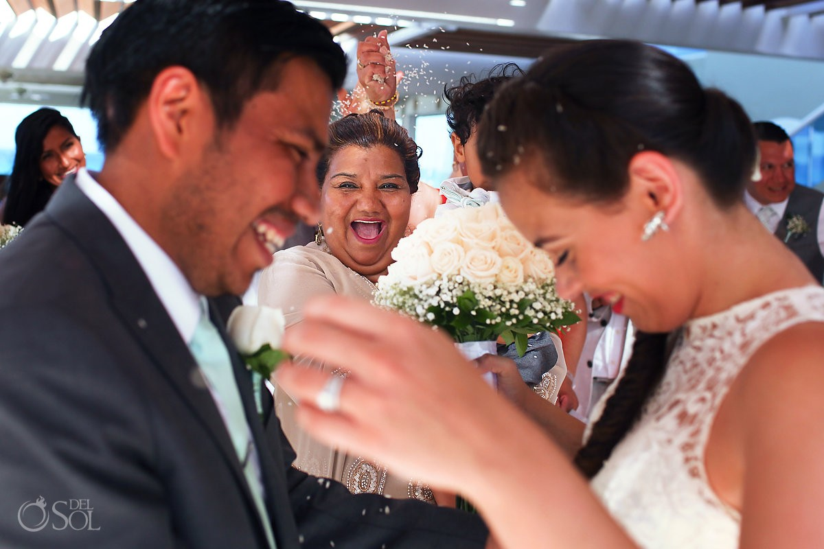 bride and groom celebrate with mothers at the wedding in Gran Caribe Real Cancun