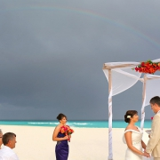 destination wedding on the beach at Iberostar cancun with rainbow