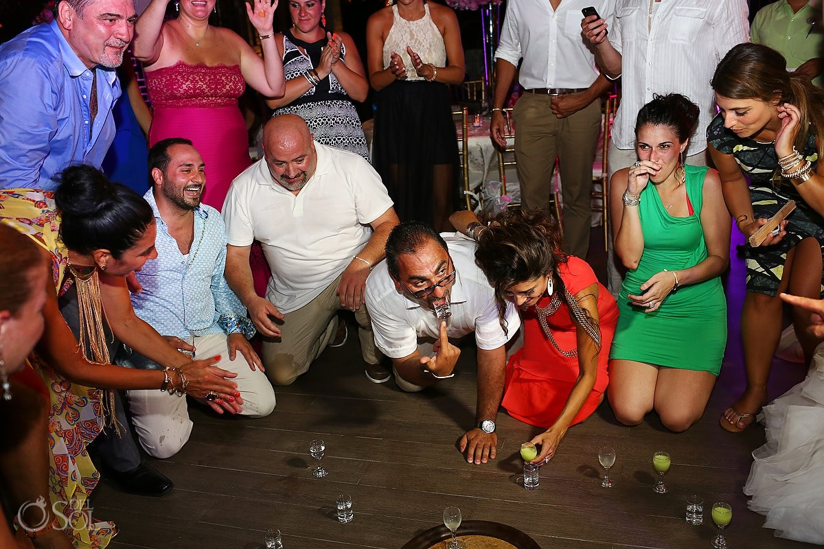 guests on the dance floor playing a drinking game at Paradisus La Esmeralda, Playa del Carmen, Mexico.