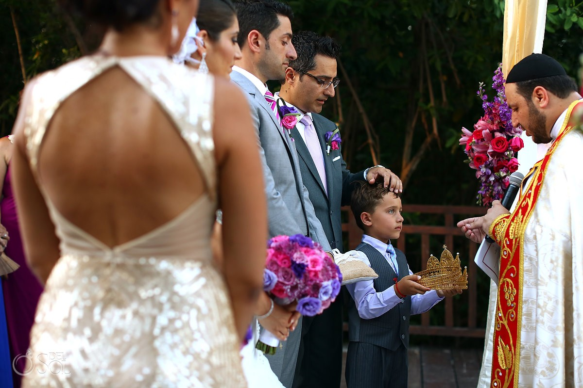 Assyrian Christian Orthodox ceremony with child passing crown at paradisus la esmeralda