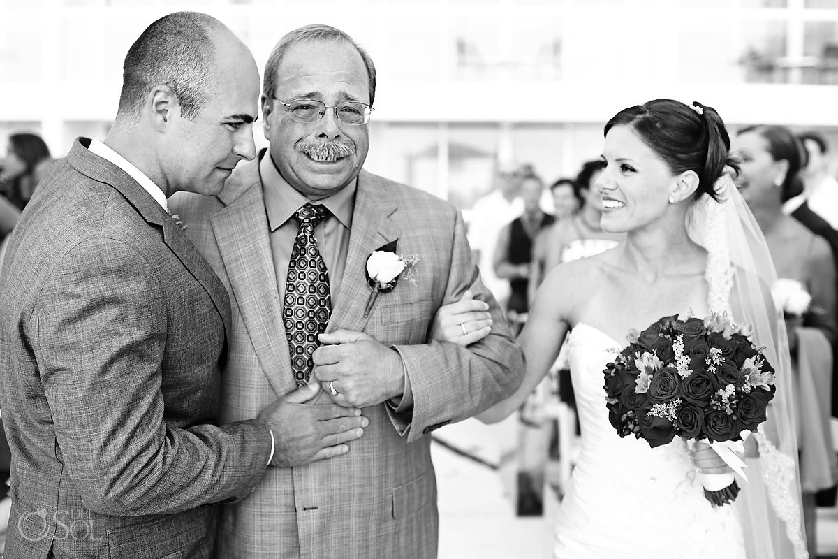 father cries as he gives his daughter away for wedding