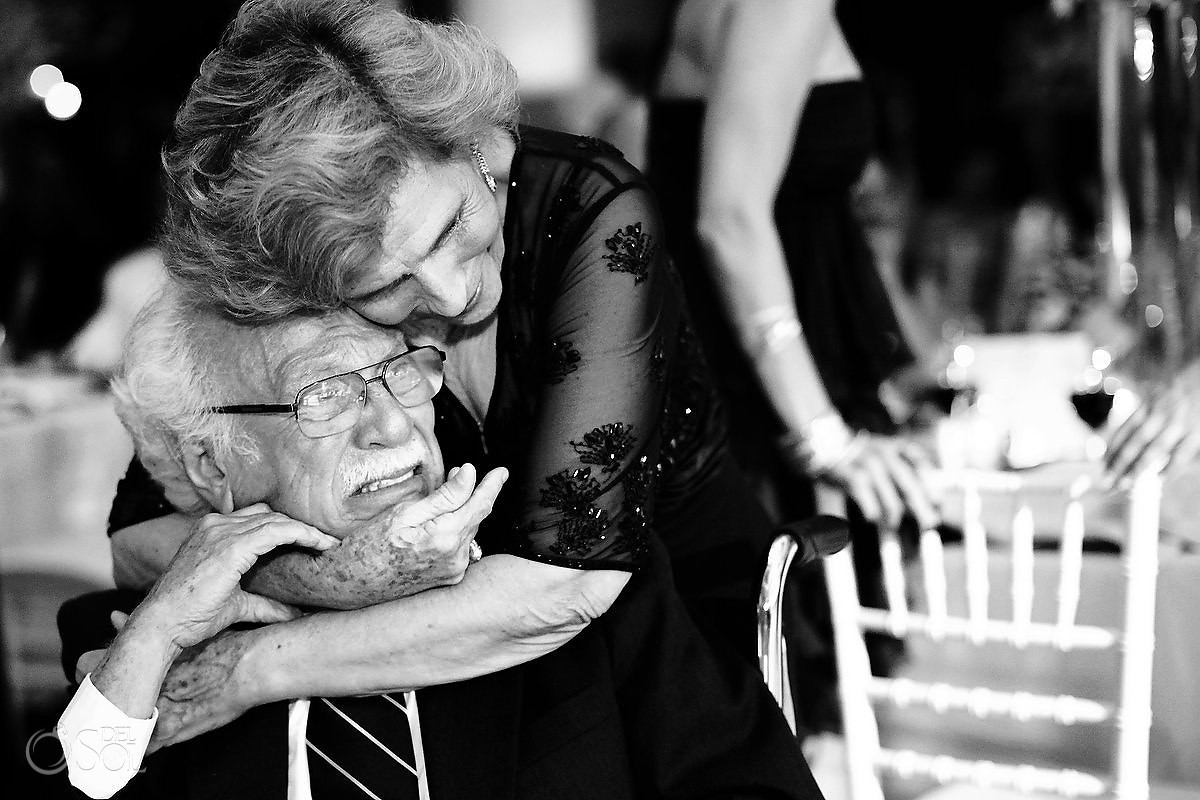 grandfather is overwhelm with emotion crying at a wedding reception