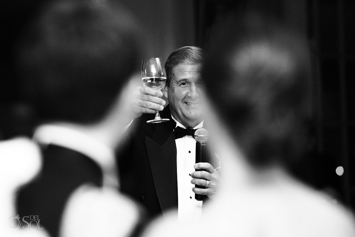 wedding photo of father of the bride toasting at wedding reception