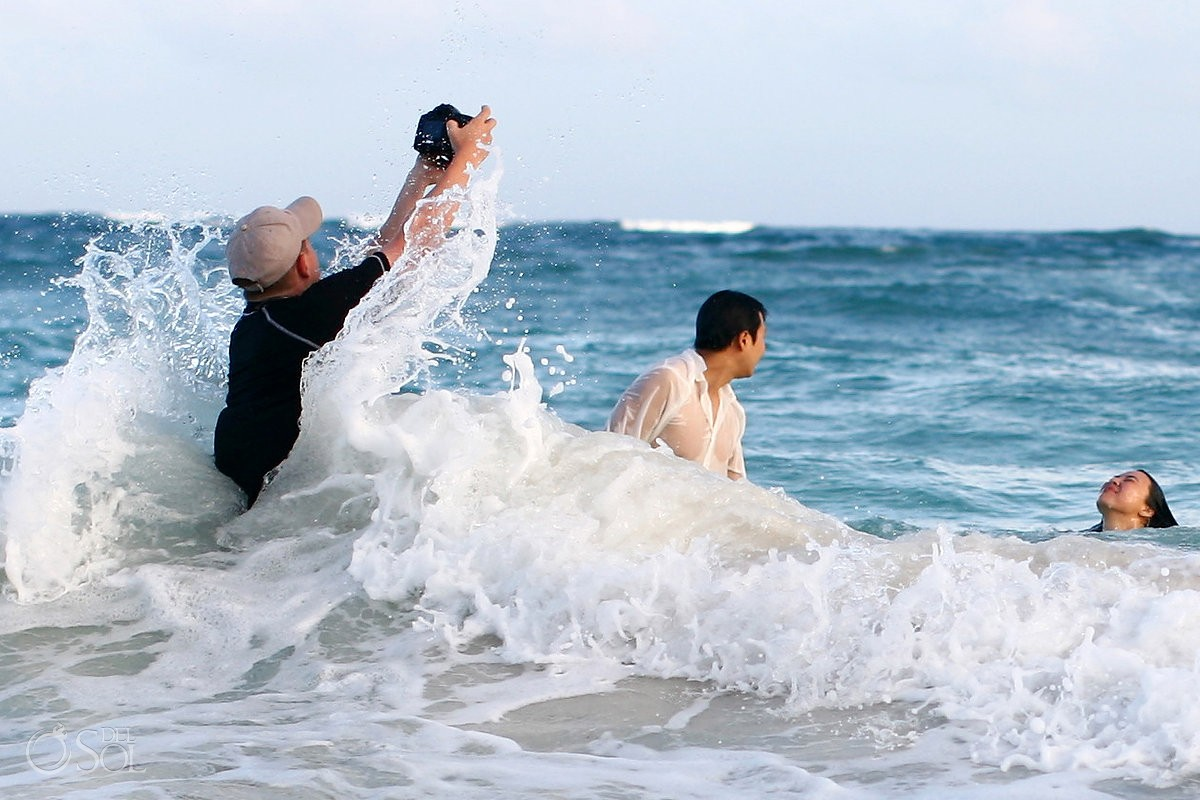 Matt Adcock camera wet from ocean wave tulum mexico bridal trash the dress photography