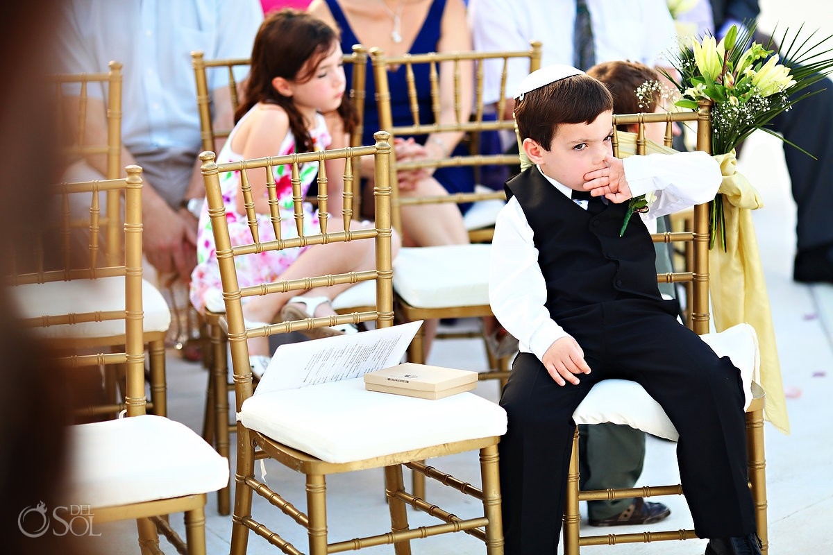 jewish child ringbearer picks nose during wedding ceremony