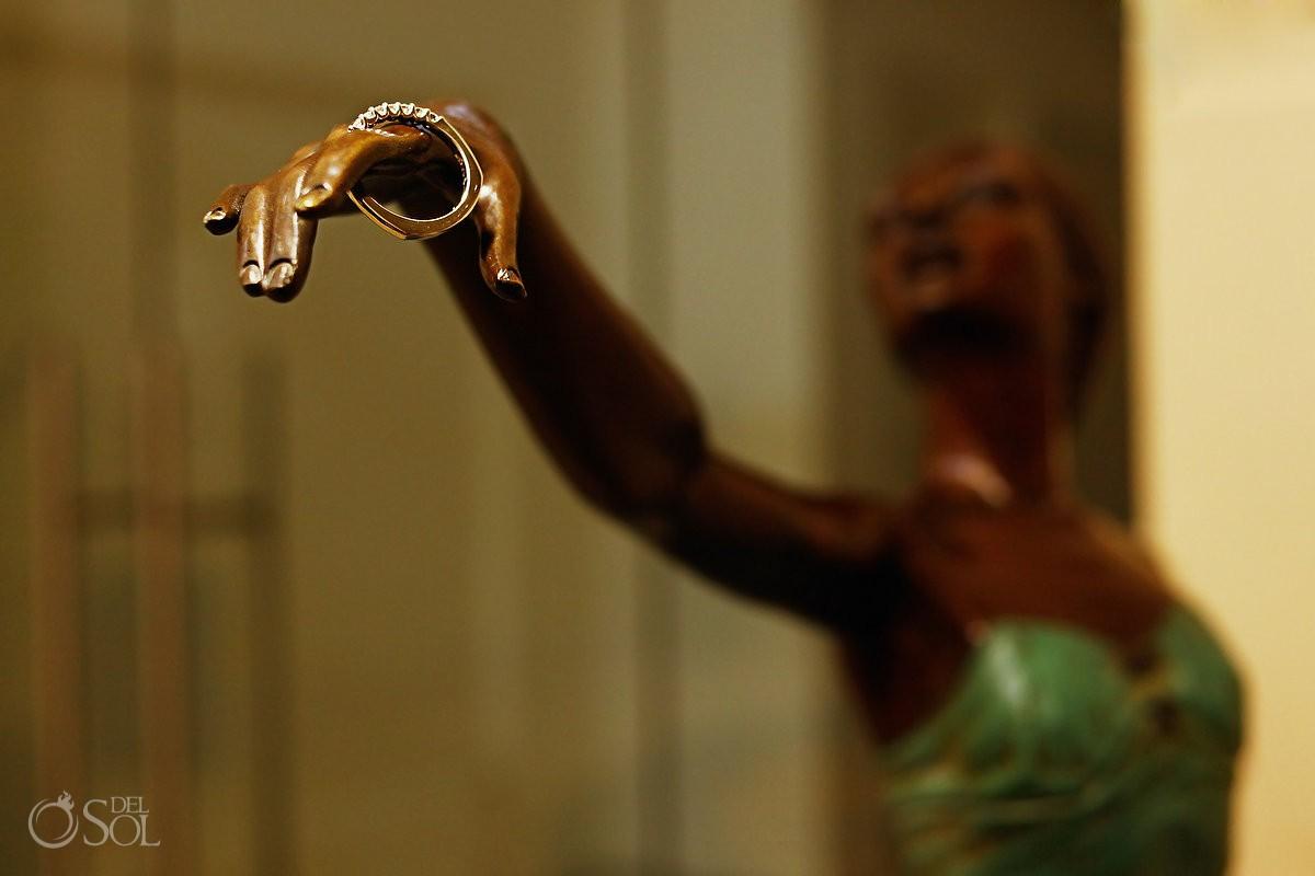 Monkey holding engagement and wedding rings