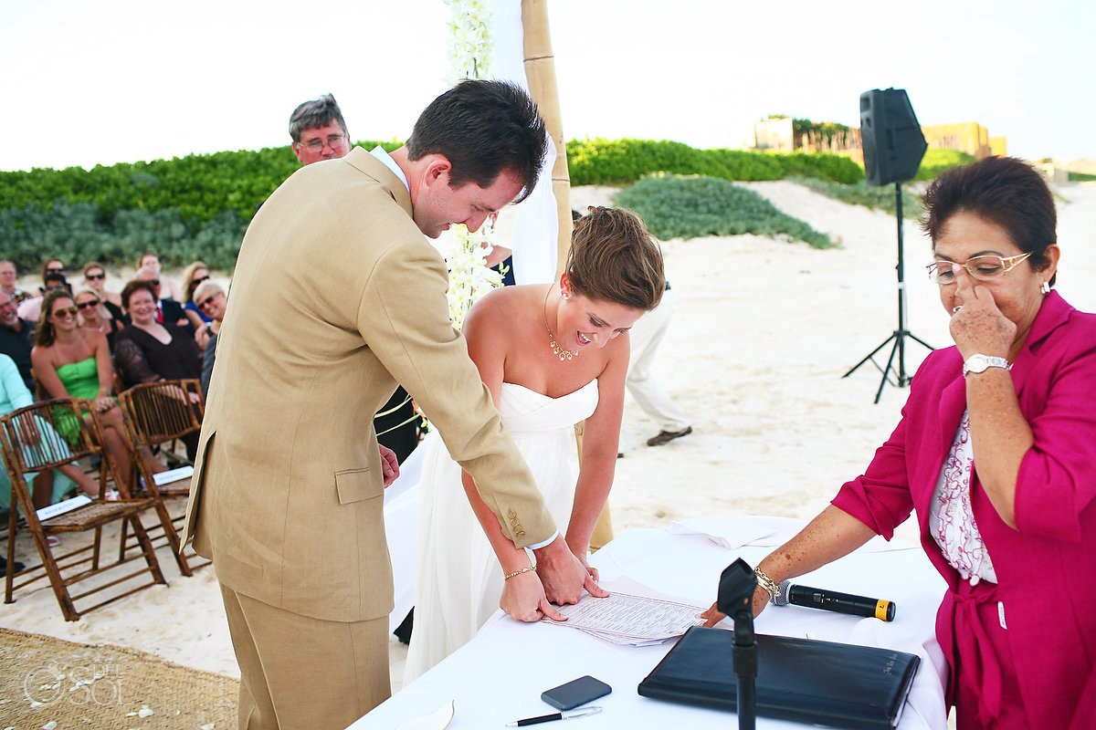 Wedding officiant giving the finger photobombs destination weddings