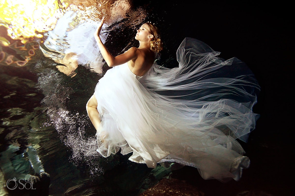 Underwater Wedding Photography trash the dress bride swimming