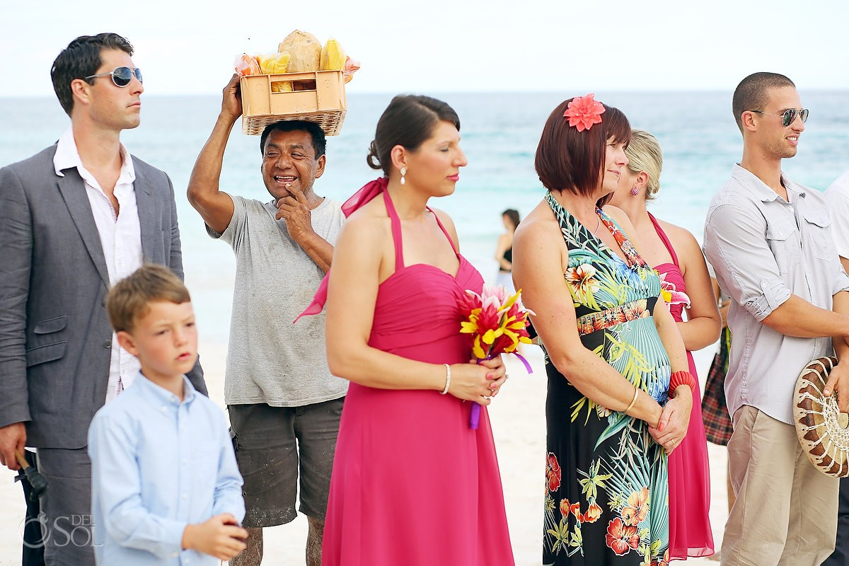 Mexico fruit vendor beach wedding photobomb