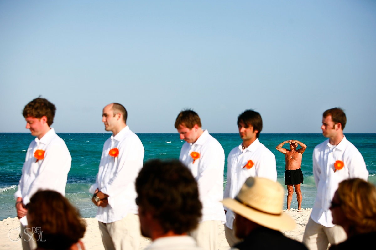 Cancun beach wedding photobomb